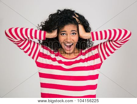 Portrait of a young afro american woman screaming isolated on a white background