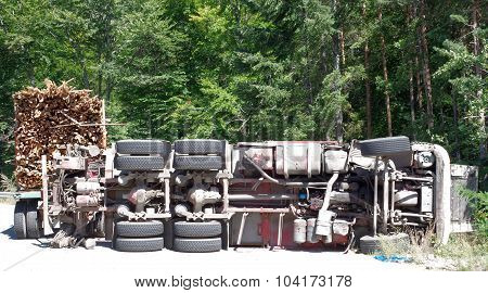 Crashed Overturning Truck With Firewood