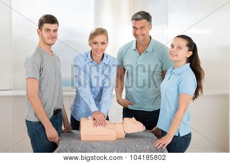 Female Students Practicing Cardiopulmonary Resuscitation Cpr On Dummy poster