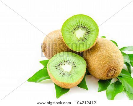 Juicy kiwi fruit and leaves isolated on white background. poster
