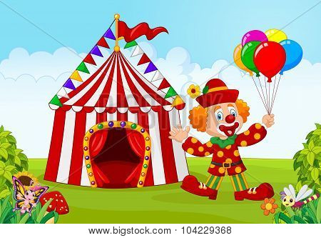 Circus tent with clown holding balloon in the green park