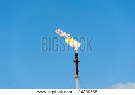 Torch on the blue sky background. Gas flaring. poster