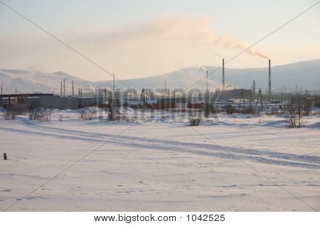 Industrial Snowy Landscape With Mountain Background