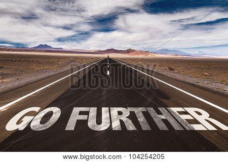 Go Further written on desert road