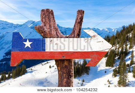 Chile Flag wooden sign with winter background