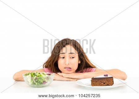 Diet Woman Deciding Between Cake And Salad