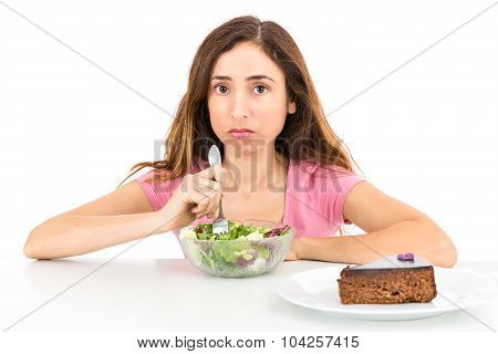 Weight Loss Woman Eating Salad Wishing For A Piece Of Cake