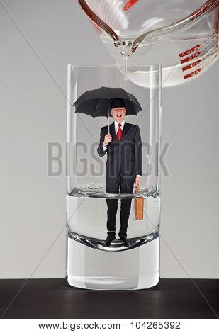 Business man inside a glass of water