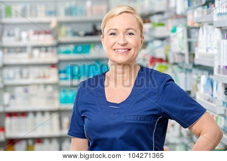 Portrait of smiling female chemist standing in pharmacy