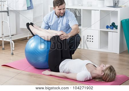 Woman During Rehabilitation Exercising
