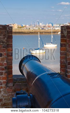 ROCHESTER, UK - MAY 16, 2015:  Old cannon of Upnor Castle looking to the river Kent. Upnor Castle is