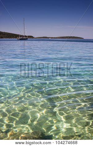 Boat In Beautiful Crystal Clear Sea