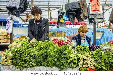 Pyatigorsk, Russia, April 3, 2015: Fresh produce vendors at farmers market in the southern Russian city of Pyatigorsk.