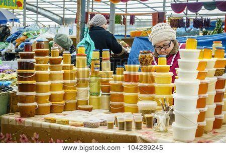 Pyatigorsk, Russia, April 3, 2015: Honey vendor at farmers market in the southern Russian city of Pyatigorsk.