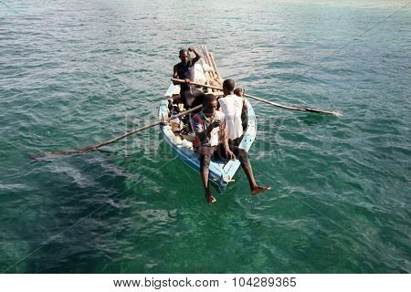 LABADEE, HAITI - SEPTEMBER 27, 2015: Fishermen fishing in their boats in the Western Caribbean Waters of Labadee, Haiti.