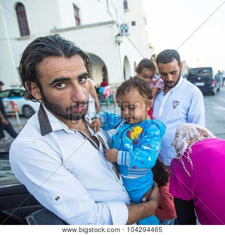 KOS, GREECE - SEP 27, 2015: Unidentified Syrian refugees. Kos island is located just 4 km from the Turkish coast and refugees come from Turkey in an boat.