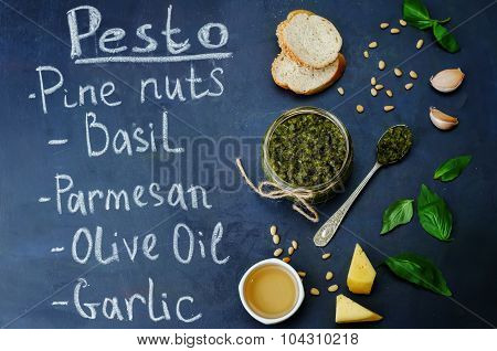 Pesto And Ingredient For Pesto Writting With Chalk On The Board With Pesto Sauce