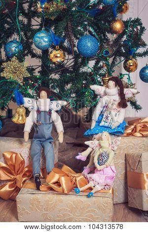 Three Funny Tilda Angels Sitting On New Year Gifts