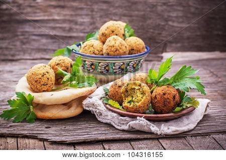 fresh falafel balls served on a wooden board