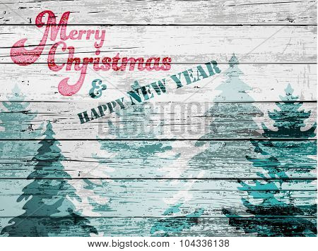 Grungy Christmas Greeting - Textured Christmas and New Year greeting card, with wood board effect and faded pine trees, whitewash, red and green