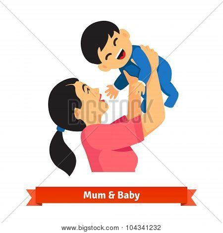 Asian mum holding up her baby in hands over head