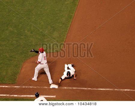 Giants Runner Slides  Back Into Base As Phillies Ryan Howard Catches Ball