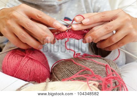 Mom Teaches A Child To Associate. Hands With Needles Close Up