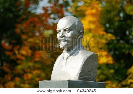 Lenin Bust Monument With Autunm Leaves On The Background