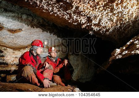 Spelunkers In A Cave