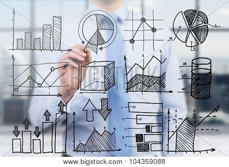 Quantitative Analyst Is Drawing Different Charts On The Glass Screen. A Concept Of Professional Fina