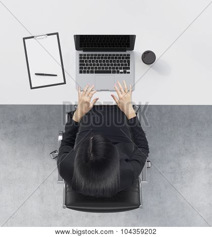 A Top View Of A Brunette At The Working Desk With A Laptop, A Writing Pad And A Cup Of Coffee. Concr