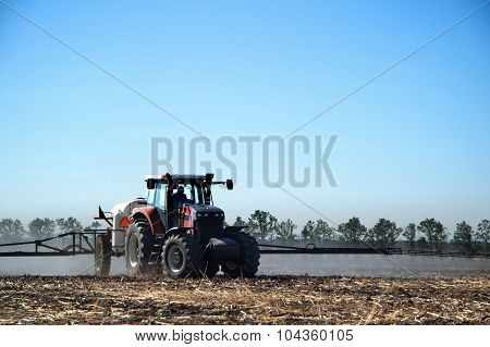 The Tractor Works In A Field