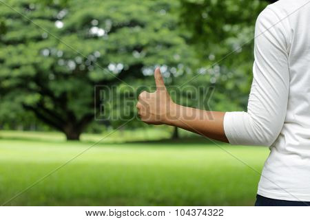 Girl Hand Thump Up In Summer Park