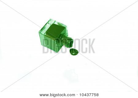 Green Nail Polish Bottle With Splatters Isolated On White Background