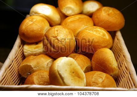Fresh Baked Bread and Rolls. A generous variety of fresh baked rolls and breads piled high and ready to be eaten at a buffet on a cruise ship. Bread is enjoyed around the world by hungry people