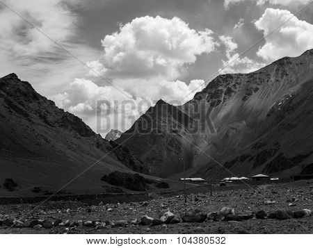 Black and white photo graphy of mountain range under the shadow of clouds in Ladakh Region India poster