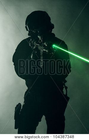 Police officer SWAT in black uniform in the smoke with laser sights poster