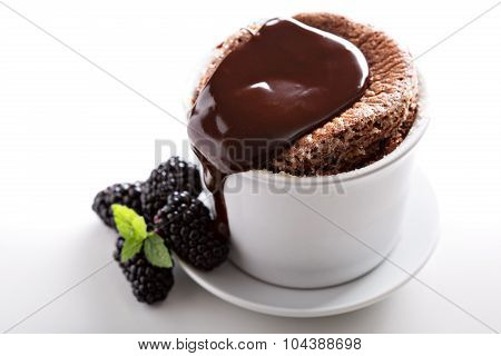Chocolate souffle with thick chocolate ganache glaze poster