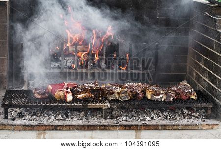 Thick slices of meat from chianina cow grilling over the embers poster