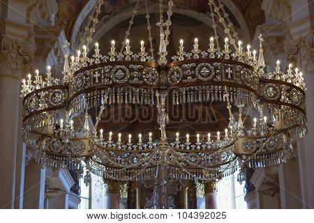Crystal chandelier with candles in the Cathedral Of St. Nicholas