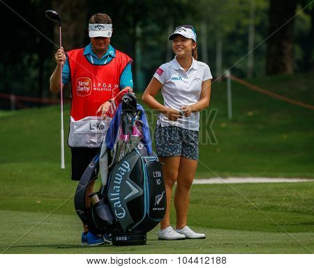 KUALA LUMPUR, MALAYSIA - OCTOBER 09, 2015: New Zealand's Lydia Ko discusses with her caddy on the sixth hole fairway of the KL Golf & Country Club at the 2015 Sime Darby LPGA Malaysia golf tournament.