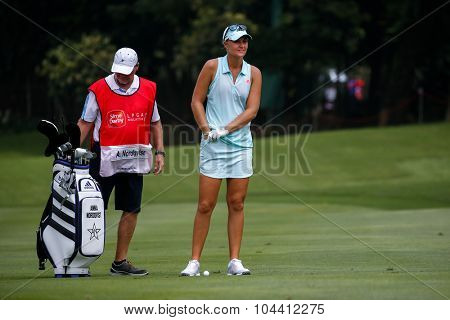KUALA LUMPUR, MALAYSIA - OCTOBER 09, 2015: Sweden's Anna Nordqvist discusses with her caddy on the 6th hole fairway of the KL Golf & Country Club at the 2015 Sime Darby LPGA Malaysia golf tournament.