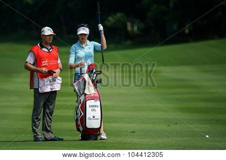 KUALA LUMPUR, MALAYSIA - OCTOBER 09, 2015: Germany's Sandra Gal discusses with her caddy on the fairway of the Kuala Lumpur Golf & Country Club at the 2015 Sime Darby LPGA Malaysia golf tournament.