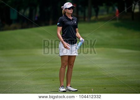 KUALA LUMPUR, MALAYSIA - OCTOBER 09, 2015: USA's Paula Creamer watches from the fairway of the sixth hole of the Kuala Lumpur Golf & Country Club at the 2015 Sime Darby LPGA Malaysia golf tournament.