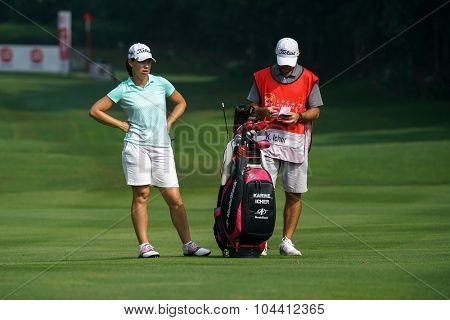 KUALA LUMPUR, MALAYSIA - OCTOBER 09, 2015: France's Karine Ischer discusses with her caddy at the 6th hole fairway at the KL Golf & Country Club at the 2015 Sime Darby LPGA Malaysia golf tournament.