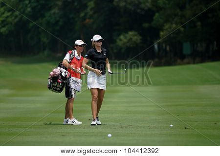 KUALA LUMPUR, MALAYSIA - OCTOBER 09, 2015: USA's Paula Creamer discusses with her caddy on the sixth hole fairway of the KL Golf & Country Club at the 2015 Sime Darby LPGA Malaysia golf tournament.