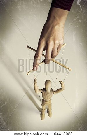 Hand manipulating a puppet