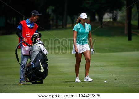 KUALA LUMPUR, MALAYSIA - OCTOBER 09, 2015: USA's Cheyenne Woods prepares to play from the 6th hole fairway at the KL Golf & Country Club at the 2015 Sime Darby LPGA Malaysia golf tournament.