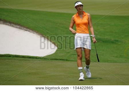 KUALA LUMPUR, MALAYSIA - OCTOBER 09, 2015: USA's Michelle Wie reacts after her putt at 18th hole green of the KL Golf & Country Club at the 2015 Sime Darby LPGA Malaysia golf tournament.