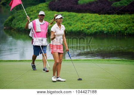 KUALA LUMPUR, MALAYSIA - OCTOBER 10, 2015: USA's Alison Lee reacts after her putt at the 18th hole of the Kuala Lumpur Golf & Country Club during the 2015 Sime Darby LPGA Malaysia golf tournament.